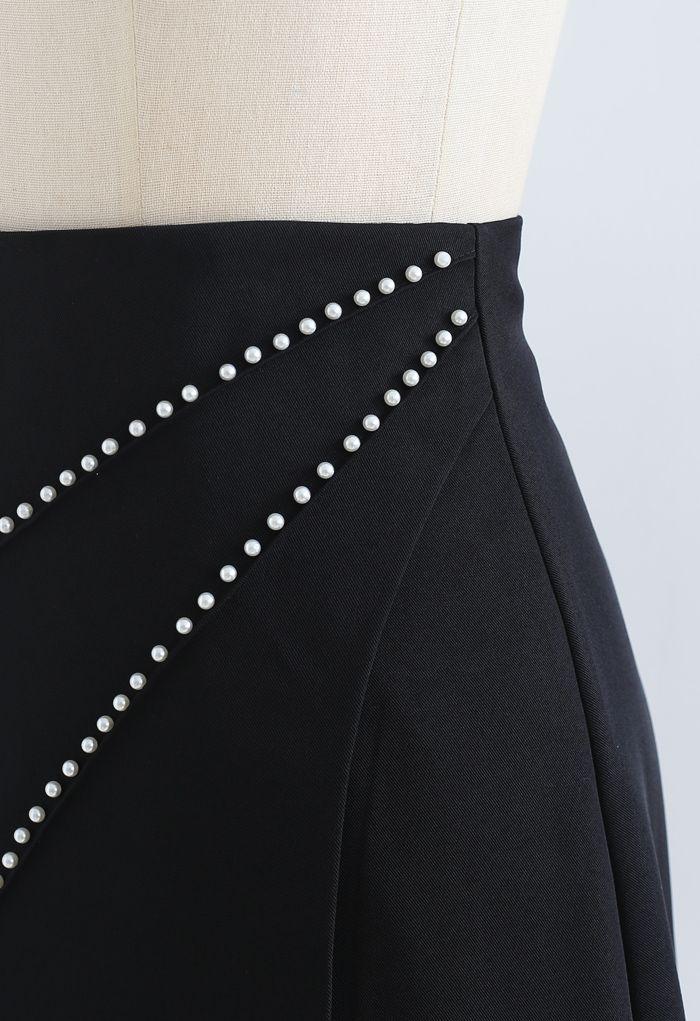 Pearls Embellished Flap Mini Skirt in Black