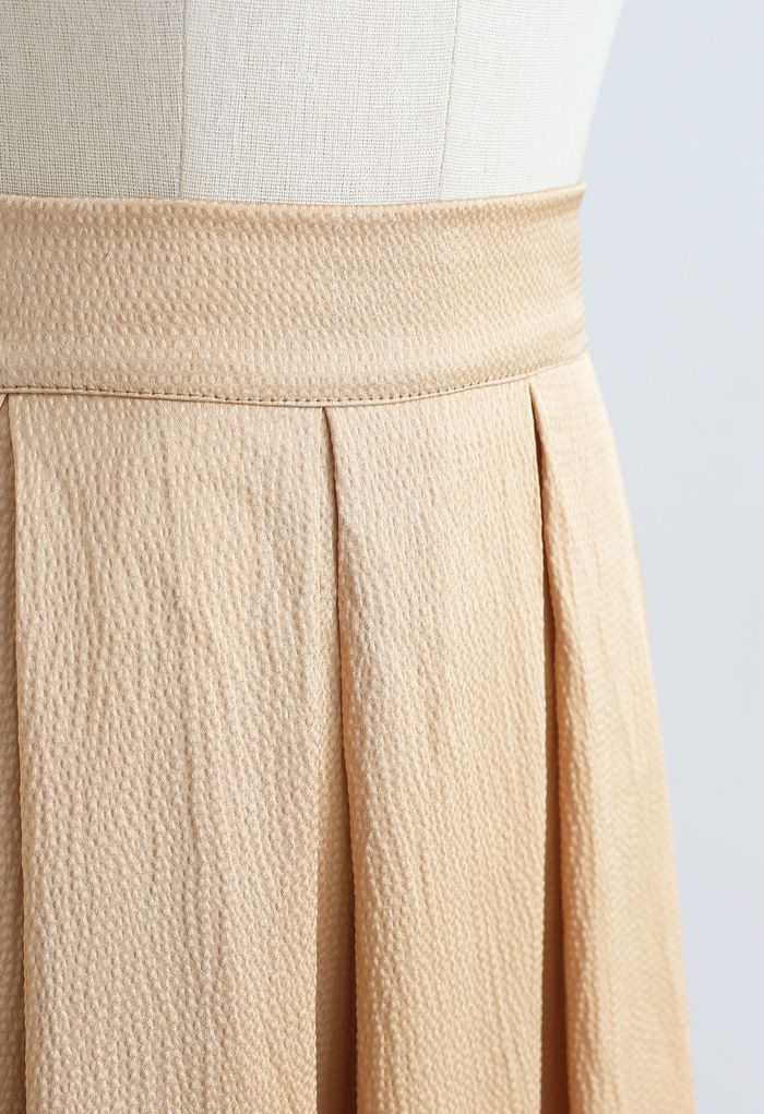 Polished Textured Pleated Midi Skirt in Apricot